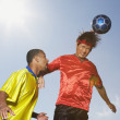 Two men playing soccer — Foto Stock