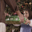 Stock Photo: Hispanic father and daughter exchanging Christmas gift
