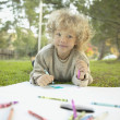 Young girl drawing outside — Stock Photo #13227677