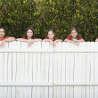 Mixed Race family leaning on fence — Stock Photo