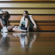 Basketball players resting on the sidelines — Stock Photo