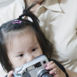 Stock Photo: Portrait of mother and daughter with camera