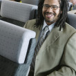 Portrait of businessman on airplane — Stock Photo
