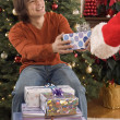 Man giving gift to Santa — Stock Photo