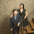 Portrait of couple on stairs — Stock Photo
