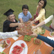 Graduating mother celebrating with family — Stock Photo