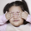 Stock Photo: Young girl covering eyes
