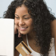 Teen girl shopping online with credit card — Stock Photo