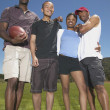 Stock Photo: Portrait of friends with football