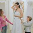 Stock Photo: Young bride-to-be trying on her gown