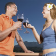 Couple toasting with wine — Stock Photo