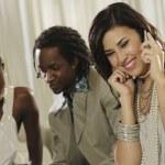 Fashionably dressed Hispanic woman talking on cell phone — Stock Photo