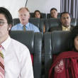 Stock Photo: Group of passengers on airplane