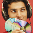 Stock Photo: Man with discs wearing headphones