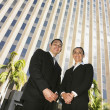 Royalty-Free Stock Photo: Low angle view of Hispanic businesspeople