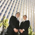 Low angle view of Hispanic businesspeople — Stock Photo