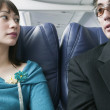 Adult couple traveling in an airplane — Stock Photo #13227974