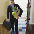 African businessman arriving at home with groceries — Stock Photo