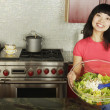 Woman holding salad serving bowl - 图库照片