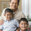 Father and sons smiling for the camera — Stock Photo #13228112
