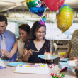 Serving cake at office birthday party — Stok fotoğraf