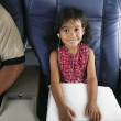 Portrait of young girl on airplane — Stockfoto