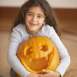 Portrait of girl hugging jack o'lantern — Stock Photo