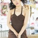 Teenage girl in brown dress — Stock Photo #13228166