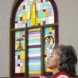 African American female Reverend praying - Stock Photo