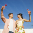 Multi-ethnic couple holding cocktails — ストック写真