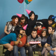 Group of young adults having birthday party — Stockfoto
