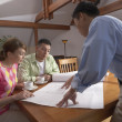 Man going over house plans with couple — Stock Photo