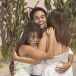Family hugging — Stock Photo
