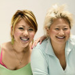 Two Asiwomen with blonde hair — Stock Photo #13228270