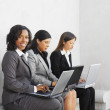 Multi-ethnic businesswomtyping on laptops — Stockfoto #13228308