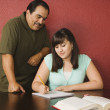 Hispanic father helping daughter with homework — Stockfoto