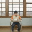 Portrait of a teenage boy in a classroom — Stock Photo
