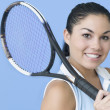 Teen girl posing with tennis racquet — ストック写真