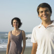 Young couple smiling on beach — Stock Photo