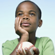 Stock Photo: African boy holding baseball