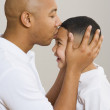 Indian father kissing son's forehead — Stock Photo