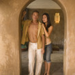 Portrait of couple standing in doorway — Stock Photo