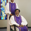 Senior African couple wearing church choir gowns — Foto de Stock