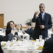 Stock Photo: Businessman making a toast at lunch