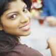 Young woman smiling for the camera — Stock Photo