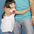Young girl hugging torso of young man - Stock Photo