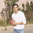 Young man playing with a football — Stock Photo