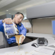 Royalty-Free Stock Photo: Asian businessman spilling coffee on desk