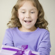 Hispanic girl holding gift — Stock Photo