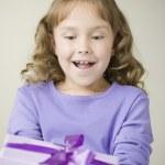 Hispanic girl holding gift — Stock Photo